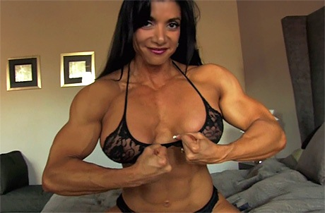 Busty Muscular Mistress with Superior Femdom Muscles